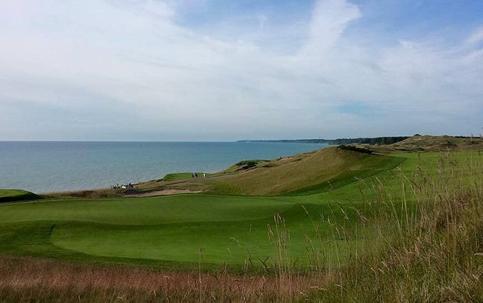 The coolest place to hang out at Whistling Straits is a barn in a parking lot